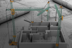 Blueprint with cranes and structural architecture model on top of it