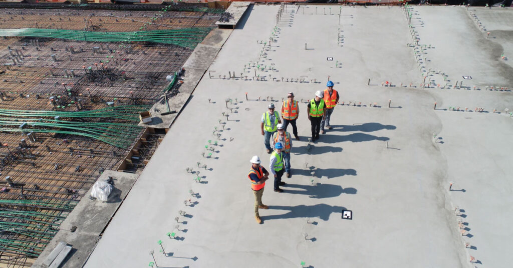 Construction workers on concrete slab
