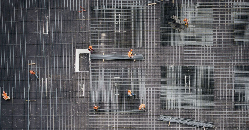 Construction workers rebar tying
