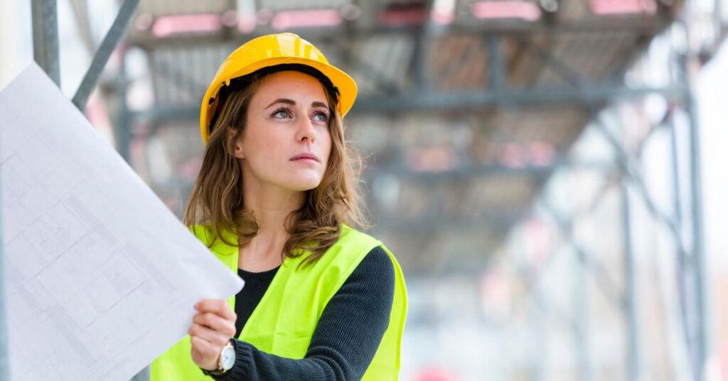 Female construction worker holding a blueprint